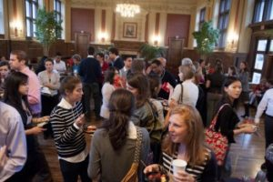Students mingling in Holmes Lounge