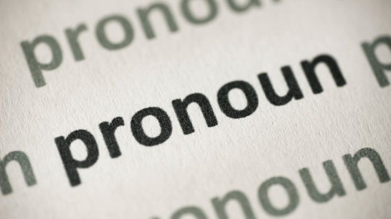 word pronoun printed on white paper macro