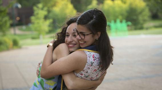 Two Rodriguez Scholars hug