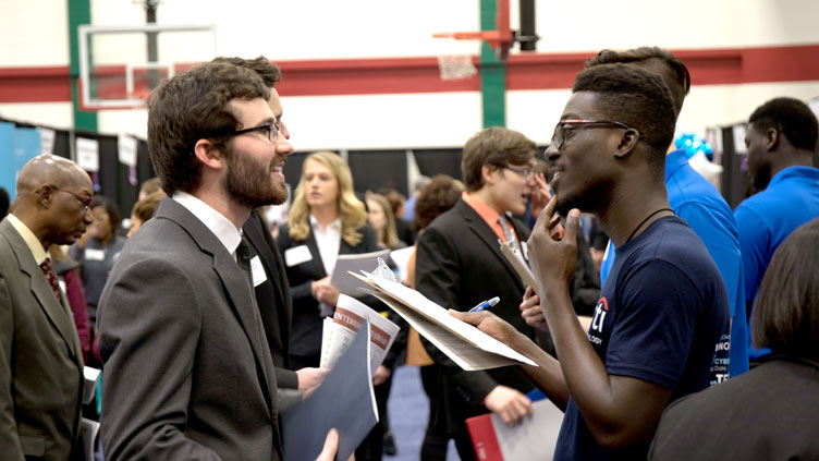 Student talks to employer at Career Fair