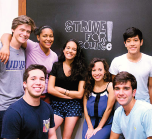 Students pose in front of Strive for College! sign