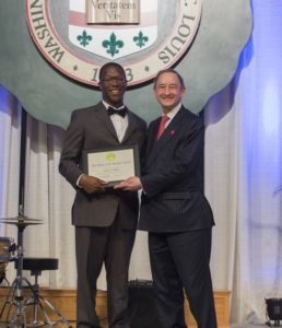 Student receiving award from Chancellor Wrighton