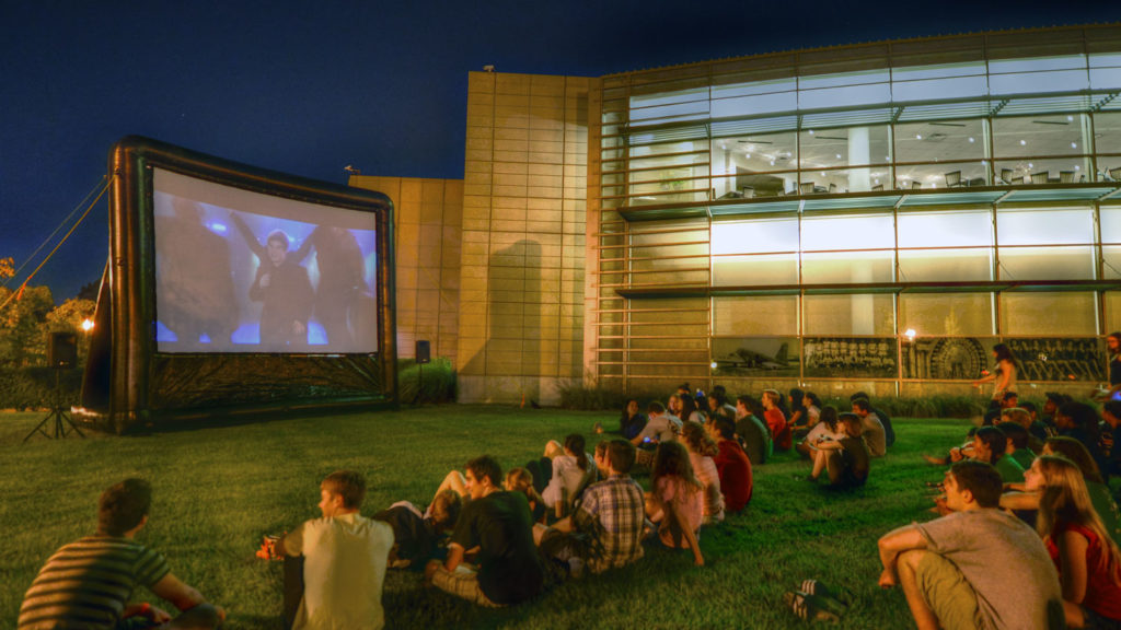 students viewing an outdoor movie screening