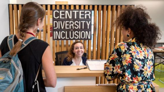 students visiting front desk at CDI