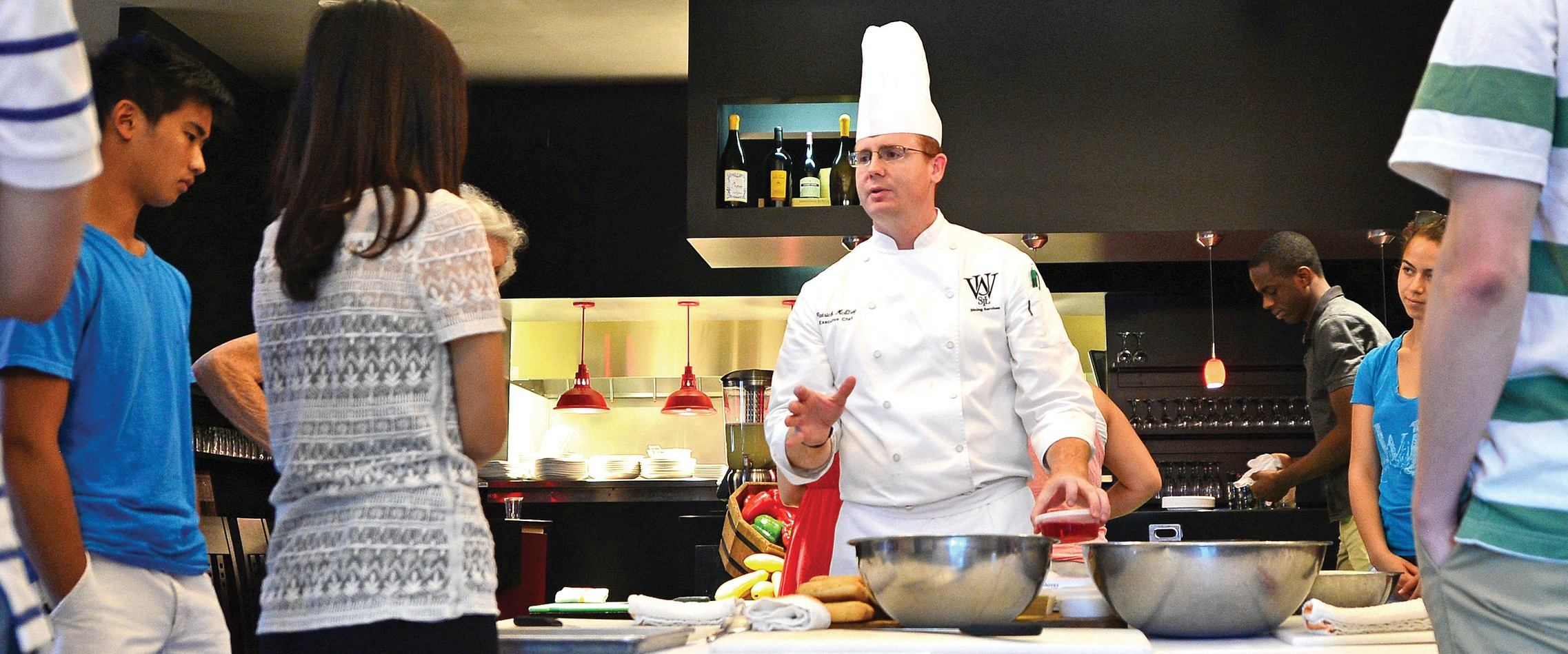 Chef speaking to students