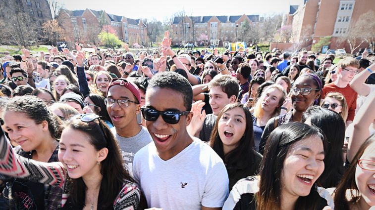 Large gathering of smiling students