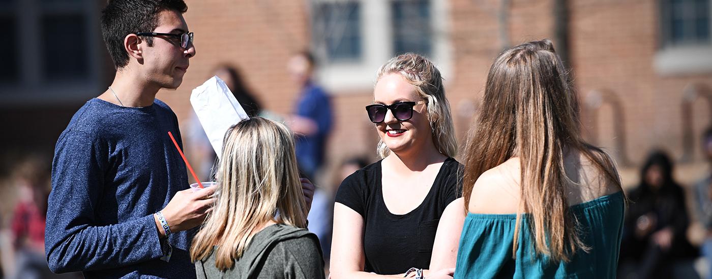Students having a conversation outside