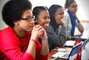 Students smile in class