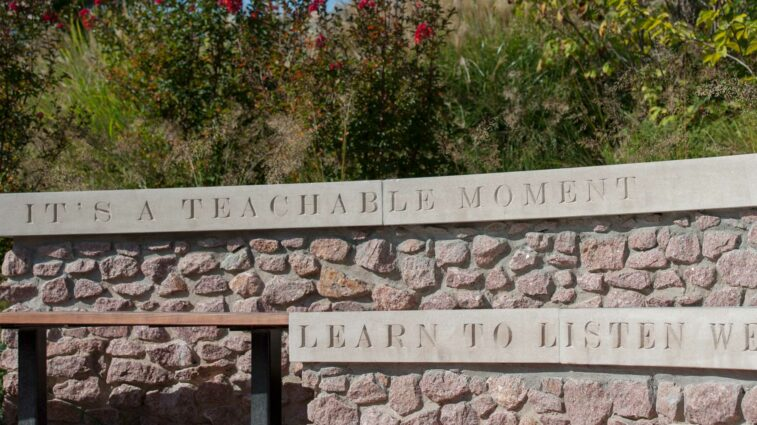 Inscriptions that read It's a teachable moment, and Learn to listen well on McLeods Way