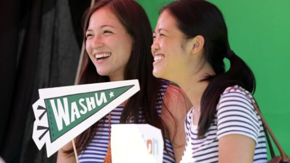 Students with WashU pennant